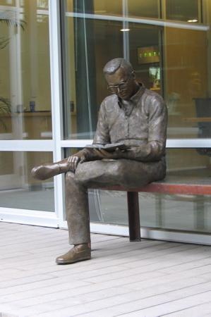 Young Man Reading LS AMY UNFRIED- Art Castings of Montana, Inc.